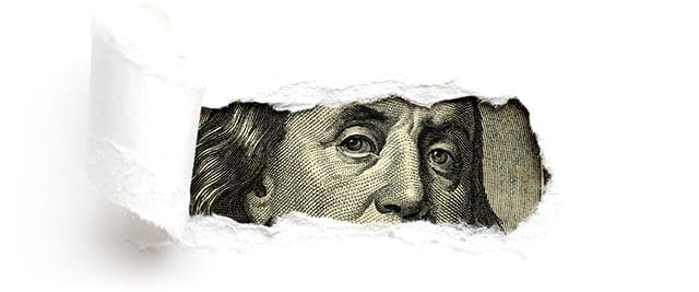 Dollarschein hinter Papier